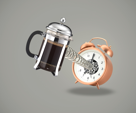 Coffee cafetiere coming out of alarm clock on spring on gray background
