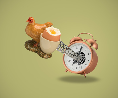 Hen Egg cup springing out of alarm clock