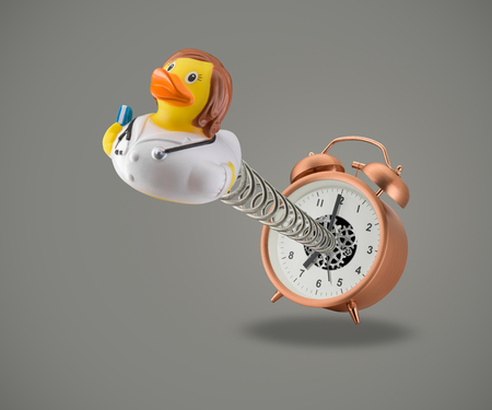 Rubber duck Doctor coming out of alarm clock