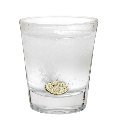 seltzer: Pound coin like alka seltzer dissolving in glass isolated on white