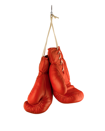 Boxing Gloves hanging on hook isolated on white background