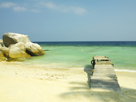 wooden jetty on sandy beach, perhentian Islands, East Malaysia Stock Photo