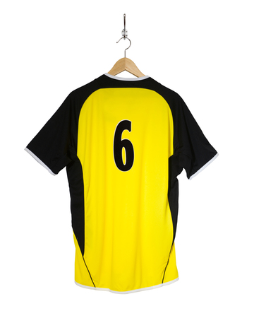 Yellow Football shirt number six hanging on hook and isolated on white background Stock Photo