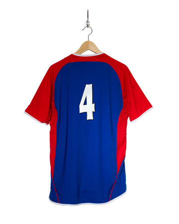 7 8: Blue Football shirt number four hanging on hook and isolated on white background