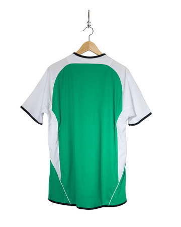 Green Football shirt hanging on hook and isolated on white background 版權商用圖片