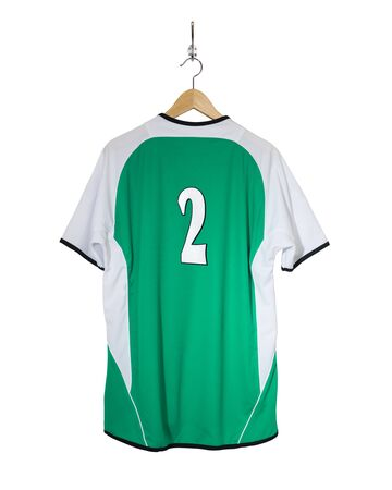 Green Football shirt number two  hanging on hook and isolated on white background Stock Photo