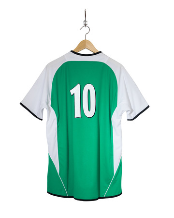 shirt hanger: Green Football shirt number ten hanging on hook and isolated on white background