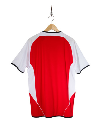 Red Football shirt hanging on hook and isolated on white background