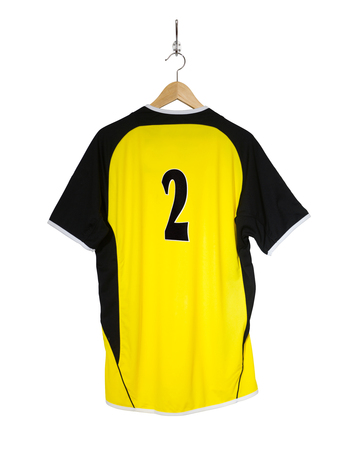 Yellow Football shirt number two hanging  on hook and isolated on white background