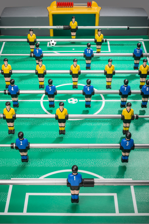 Table football with players and numbered shirts