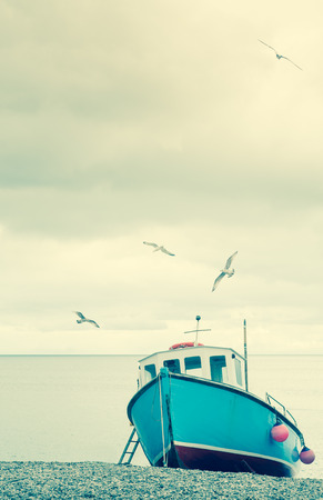 Fishing Boats on beach with seagulls