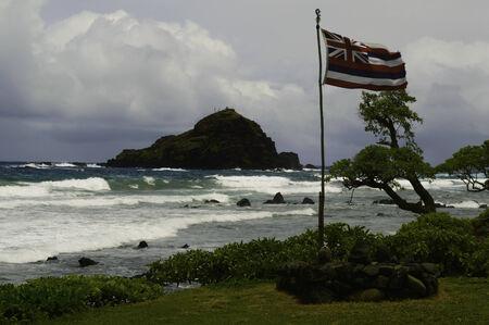 hawaii flag: An old Hawaii flag flies on a stormy day on the south coast of Maui