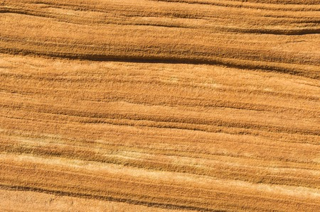 Sandstone Textured Background close up of the red Navajo sandstone cliffs in Grand Staircase National Monument, Escalante Utah