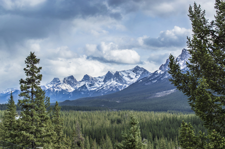 snow capped: A view of the Bow Valley and snow capped mountains on a stormy day in Banff National Park, Alberta Canada