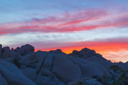 granite park: A red Sunset over the granite rocks of Joshua Tree National Park