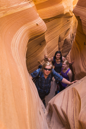 escalante: 3 young hikers in Zebra Slot Canyon in Grand Staircase National Monument Escalante Utah