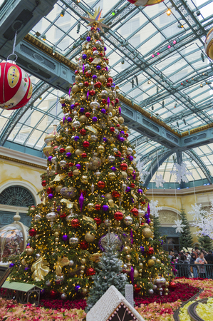 large tree: Las Vegas, Nevada, USA - December 24, 2014: A Christmas display at the Bellagio Hotel and Casino in Las Vegas of a large Christmas tree.