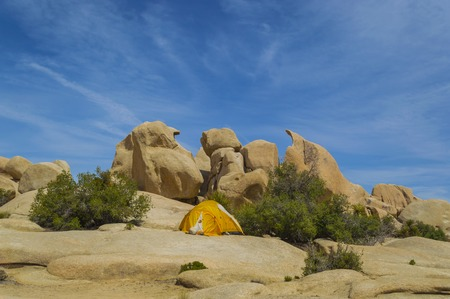 joshua tree national park: A tent set up on the rocks in Joshua Tree National Park, Mohave desert, California, USA