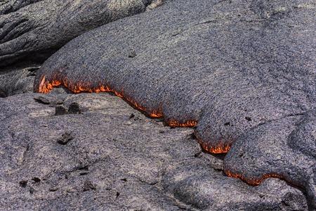 Lava flowing near Puuoo Crater Volcanoes National Park Big Island Hawaii Stock Photo
