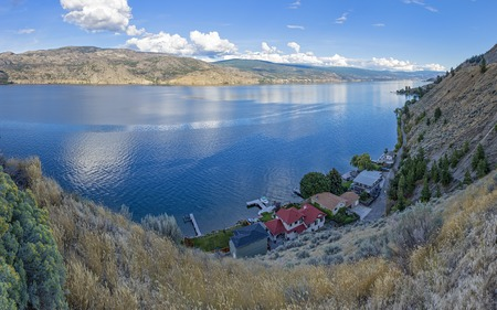 subdivision: Okanagan Lake near Summerland British Columbia Canada with a lakefront subdivision in the Foreground
