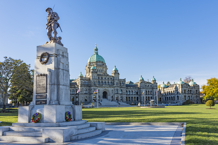 British Columbia Parliament Building with War Memorial in the foreground on a sunny day Victoria BC Canada Stock Photo