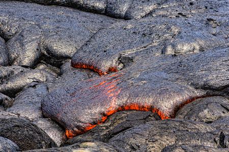 Lava flowing near Puuoo Crater Volcanoes National Park Big Island Hawaii Фото со стока