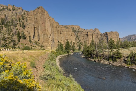 Red rock cliffs over the North Fork Shoshone River East of Yellowstone National Park Near Cody Wyoming