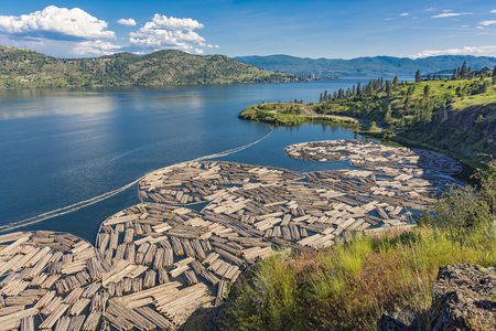 Log Booms on Okanagan Lake with Kelowna British Columbia Canada in the Background on a summer day