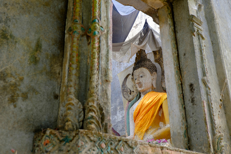 sangkhla buri: Buddha statue in decadent chapel at Sangkhla Buri, Thailand Stock Photo