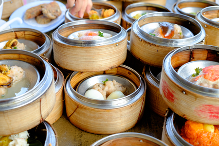 The Arrangement of various dim sum in bamboo steamer