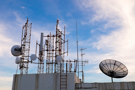 Various types of communication devices that are located on the top of the building Stock Photo