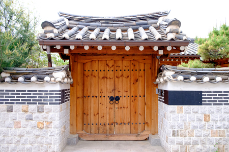 korean traditional door with walls made of cement Stock Photo