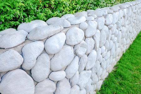 Walls are made of nature white stone and green grass Stock Photo