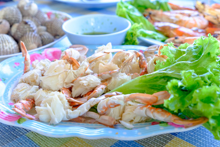Steamed crabs peeled off and crab meat put it on a plate with other food Stock Photo