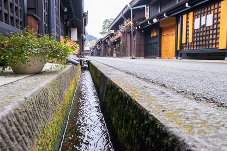 Watercourse with the old and authentic traditional Japanese village