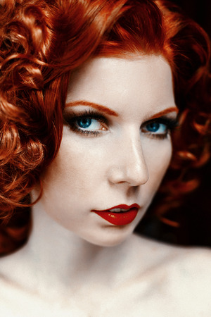 Pretty red-haired girl face with curls Stock Photo