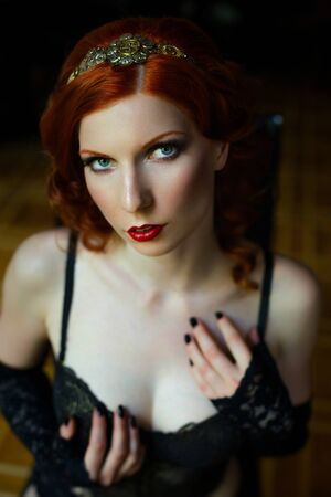 redhaired: Pretty red-haired girl face with curls Stock Photo
