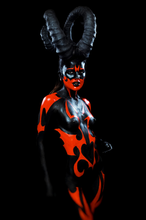 sexy devil: Beautiful demon woman with horns Stock Photo