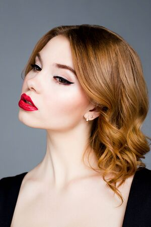 Beauty Fashion Model Woman face. Beautiful Girl Portrait with red Lips. Beautiful Woman with Luxury Makeup. Skin care concept. Fresh Clean Skin.