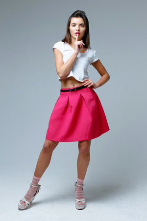 Fashionable beautiful woman wearing pink skirt