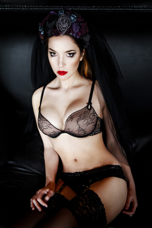 silk bra: Beautiful woman in stockings and lingerie with a wreath on head. Beauty female. Perfect skin and make up. Red lips Stock Photo