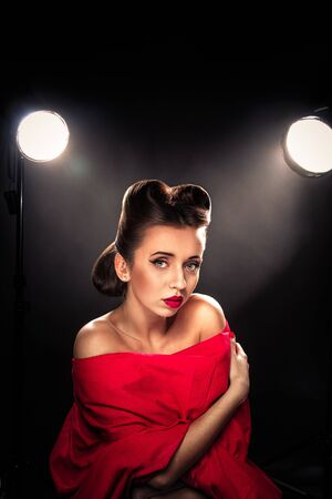 upsweep: Portrait of Styled Woman with brunette Hair Style and red lips