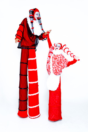 Two cheerful clown dressed in red and white cloth on a white background Stock Photo