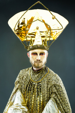 to conceal: Beautiful Golden Venetian Carnival Masked man, sun costume