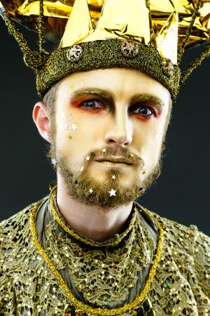 mardigras: Beautiful Golden Venetian Carnival Masked man, sun costume