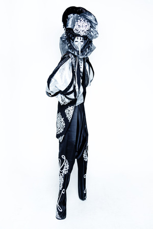 to conceal: Beautiful black an white Venetian Carnival Masked man