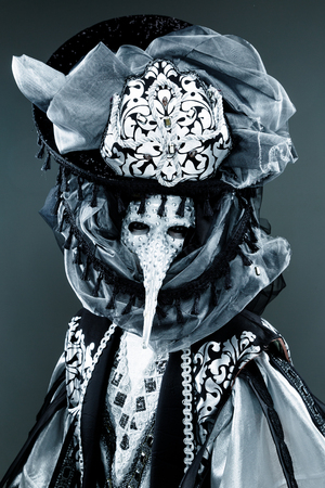 to conceal: Portrait of Beautiful black an white Venetian Carnival Masked man Stock Photo