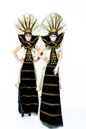 to conceal: Beautiful Golden Venetian Carnival Masked women on white background, sun costume Stock Photo