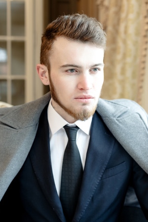 Close up portrait picture of a handsome young business man