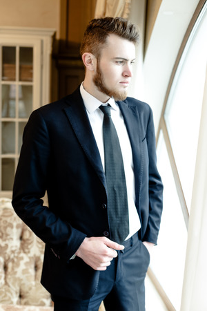 undone: Close up picture of a handsome young business man Stock Photo